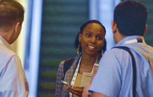 Woman interacting with peers at the 2014 NAEM EHS Management Forum