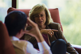 woman sitting on chair having a discussion