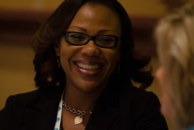 african american woman attendee smiling